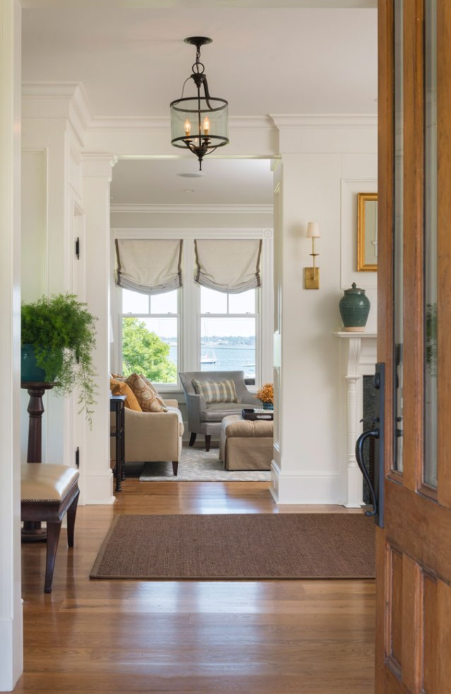 the original front door saved by our clients and replicated mouldings honor the past while functioning for the future