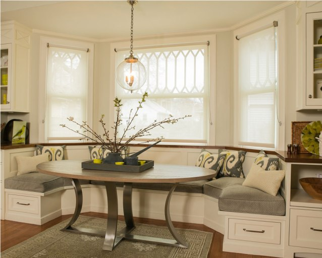 the addition of a bay window creates comfort and function in the family's kitchen