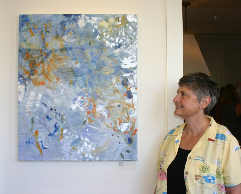 susan-strauss-with-art-at-taste-grand-opening