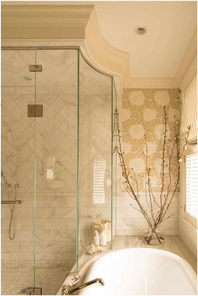 taste-design-inc-custom-glass-shower-with-chevron-marble-tile-and-tub-surround